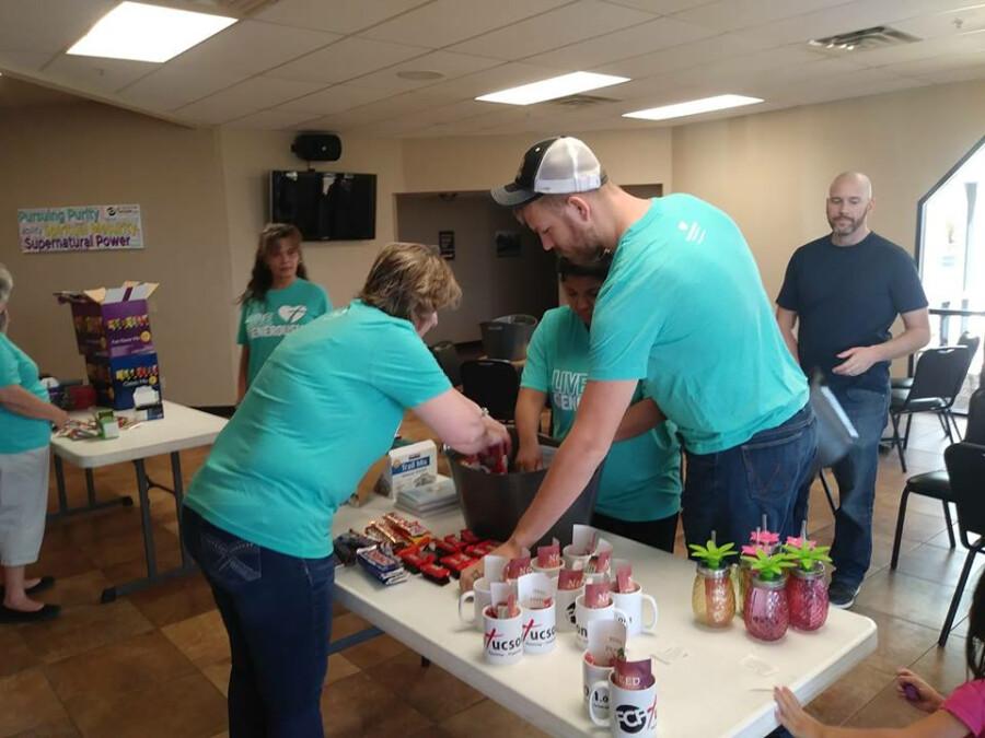 Volunteers assembling baskets