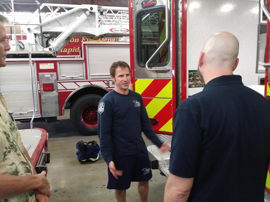 Pastor John with Firefighter